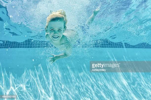 Happy swimming boy underwater