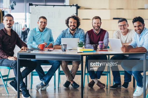 Happy team of professionals on a meeting