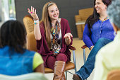 Teenager talking during therapy support group meeting