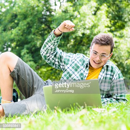 Happy teenage boy cheering : Stock Photo