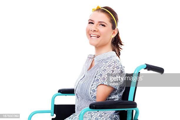 Glücklich Teenager-Mädchen In einem Rollstuhl, Studio-Portrait