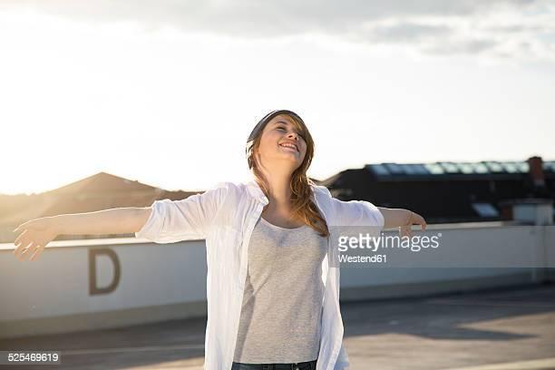 Happy teenage girl on parking lot