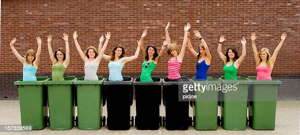 happy teenage girls in garbage containers
