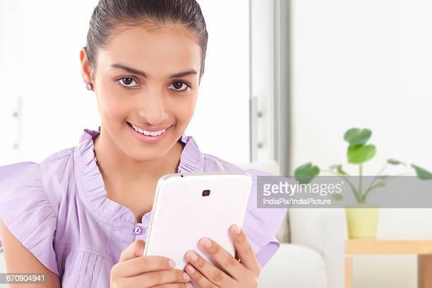 happy Teenage Girls looking at new tablet