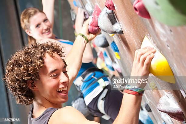 Happy Teenagers Having Fun in a Rock Climbing Gym