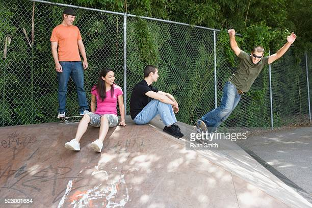 Happy Teens Hanging Out at Skate Park