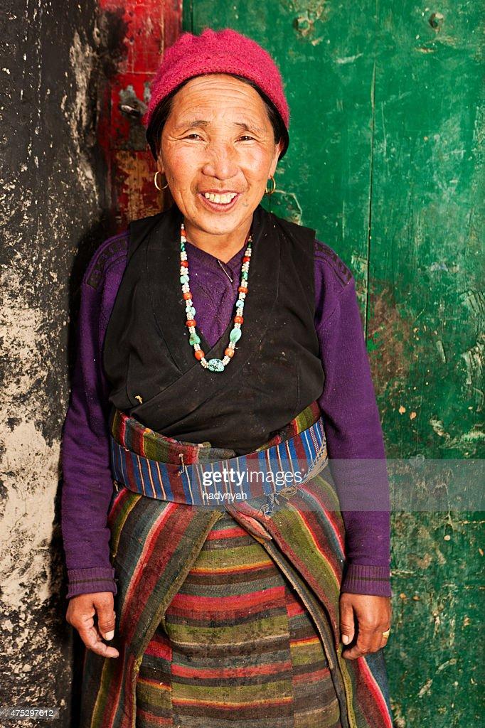 Happy Tibetan woman in Mustang region, Nepal