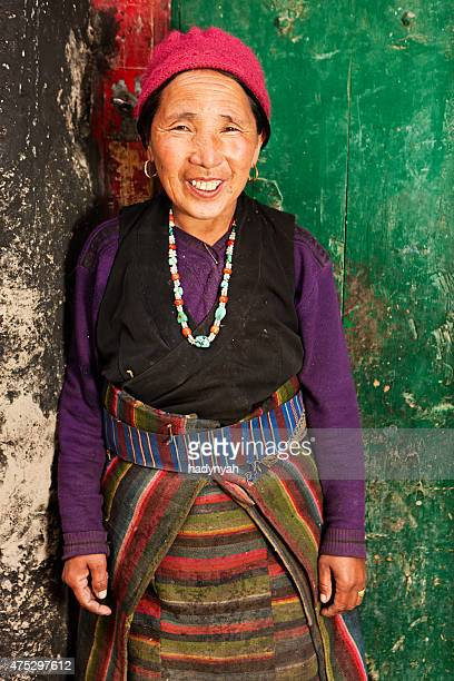 Happy Tibetan woman in Mustang region, Nepal