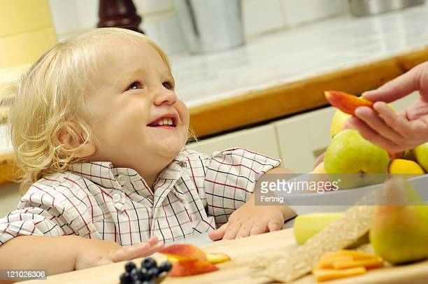 Happy toddler with healthy food