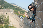 Happy female tourist on the Great Wall of China