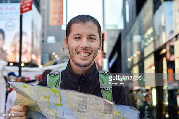 Happy tourist with map in New York City