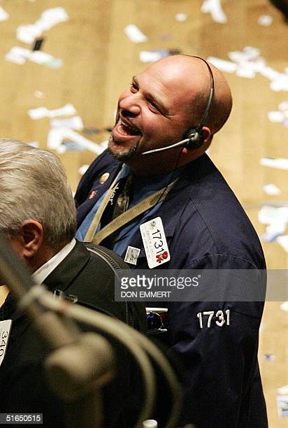 A happy trader on the floor of the New York Stock Exchange 03 November 2004 in New York Wall Street shares roared higher Wednesday as investors...