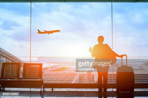 happy traveler waiting for the flight in airport : Stock Photo