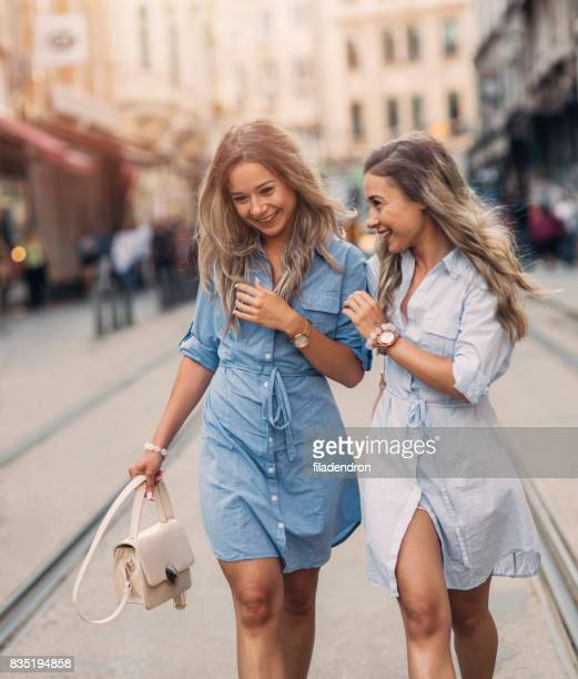 Happy twins in the city