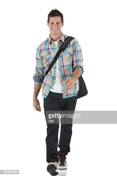 Happy university student walking