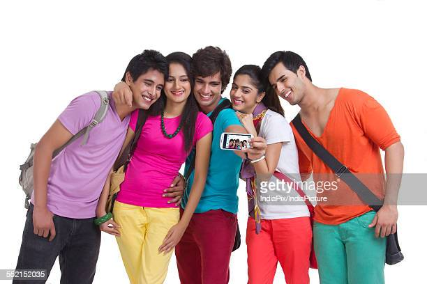 Happy university students taking picture of themselves on white background