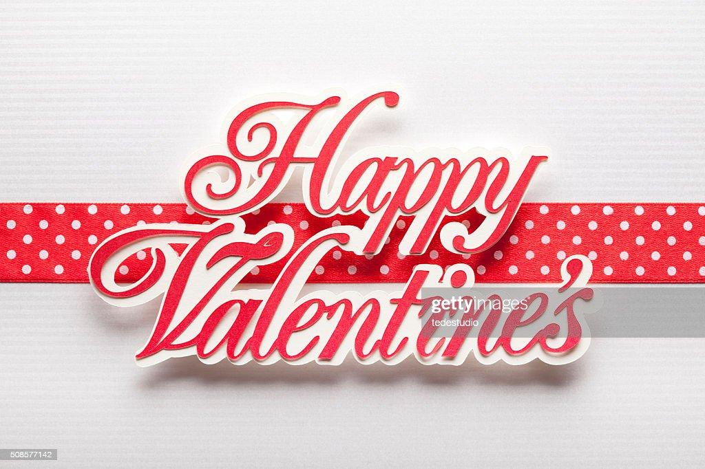 Happy Valentine's - paper sign on paper background : Bildbanksbilder