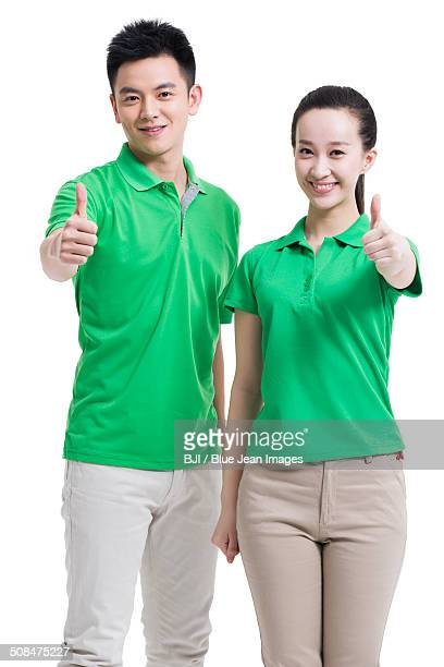Happy volunteers giving thumbs up