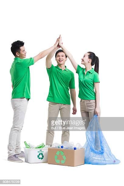 Happy volunteers high fiving
