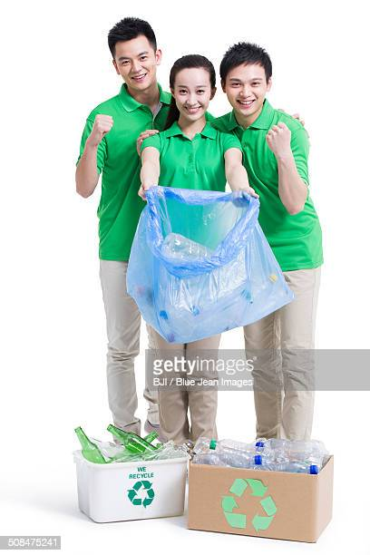 Happy volunteers recycling