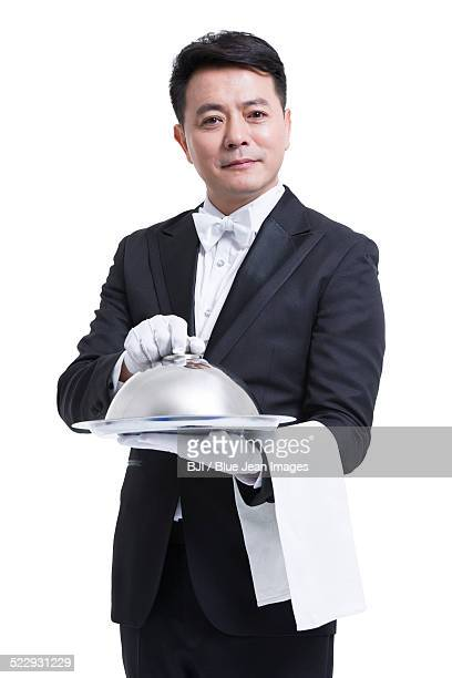 Happy waiter serving food