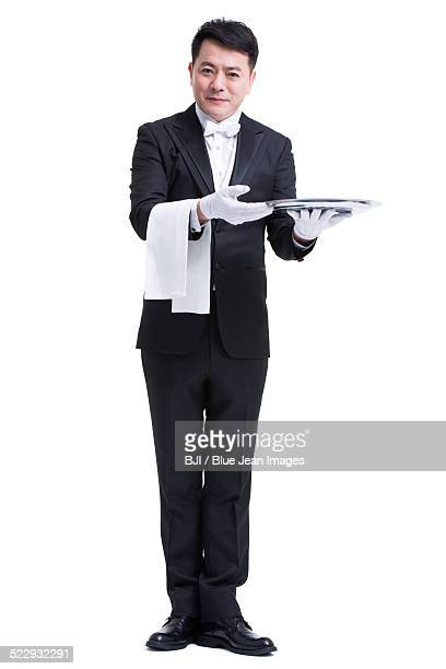Happy waiter with serving tray