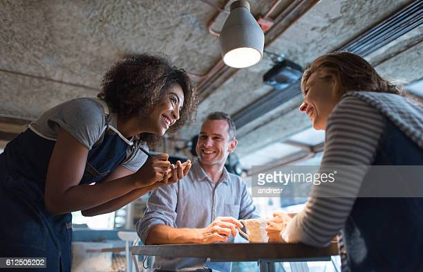Happy waitress taking an order at a restaurant