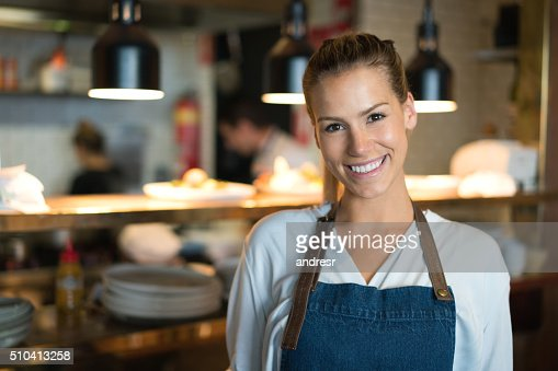 Happy waitress working at a restaurant