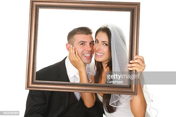 happy wedding couple in frame