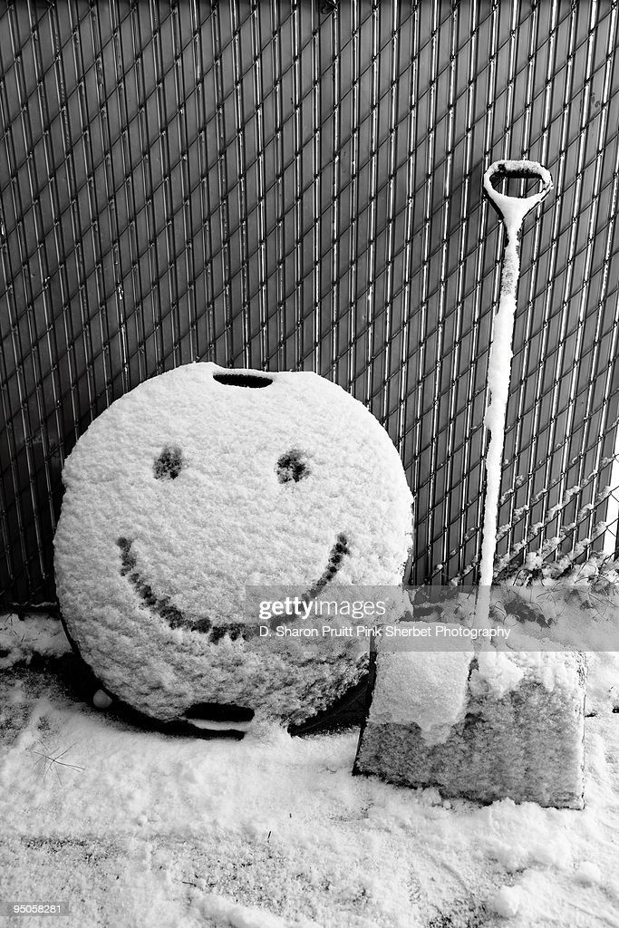 Happy Winter Snow Shovel and Smiley Face : Stock Photo