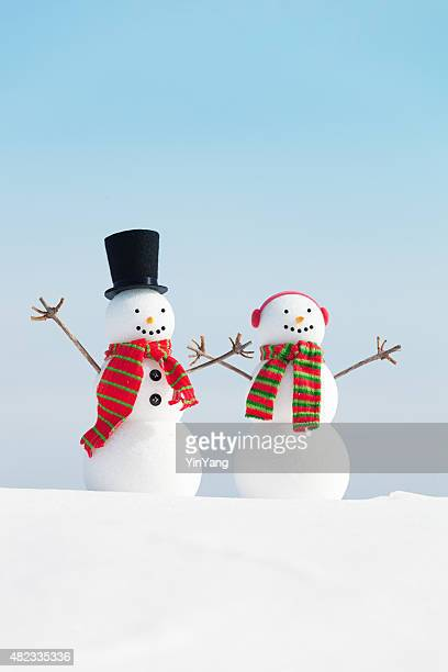 Happy Winter Snowman Christmas Couple in Snow Scene