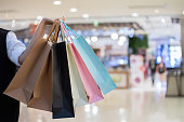 Happy woman are shopping with shopping bags on street and enjoy in lifestye