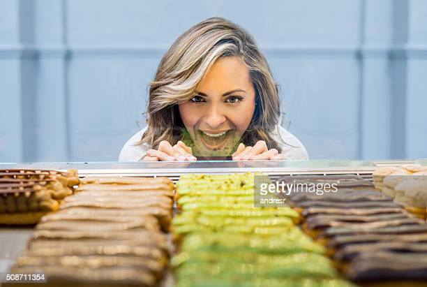 Happy woman at a pastry shop