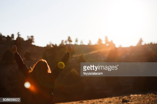 Happy woman at sunrise in nature. : Stock Photo