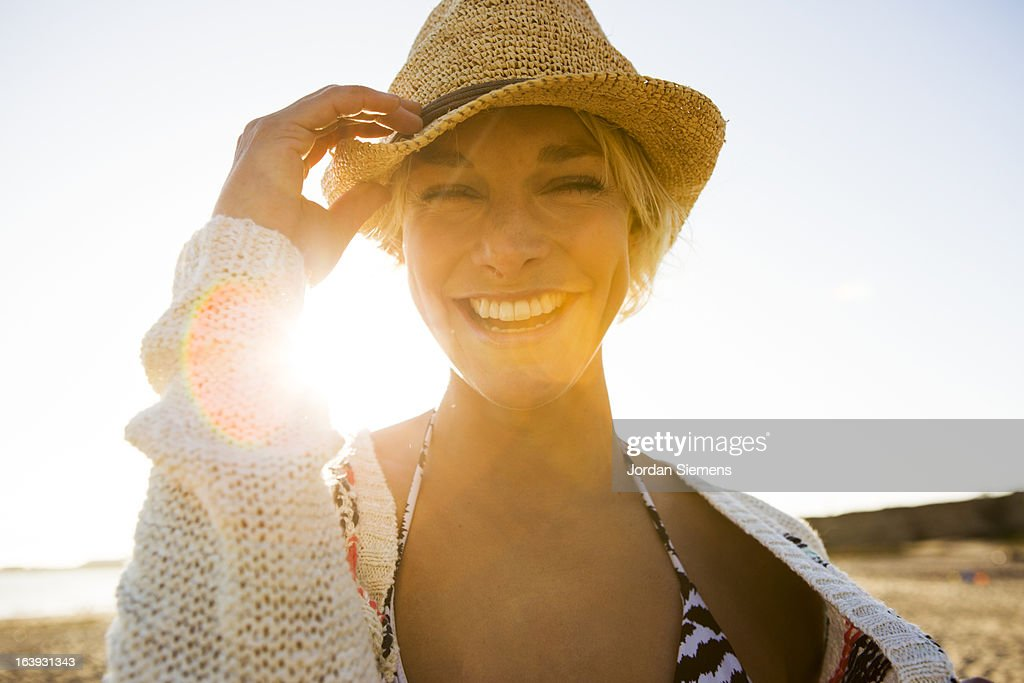 A happy woman at the beach.