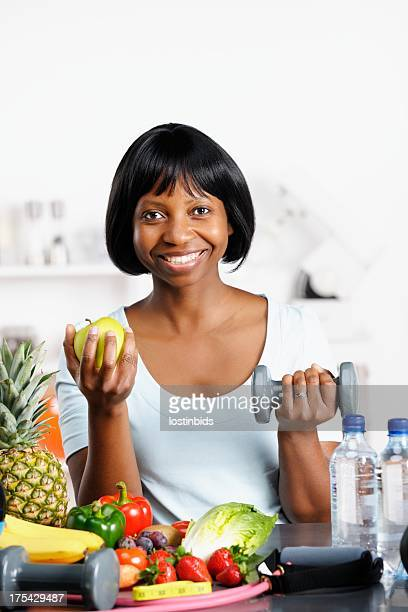 Happy Woman Balancing A Healthy Diet And Exercise