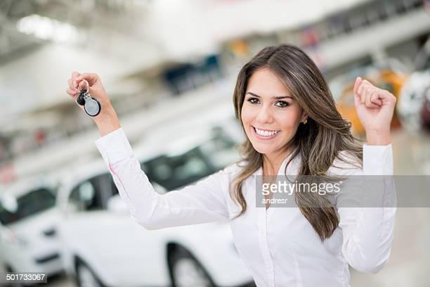 Happy woman buying a car