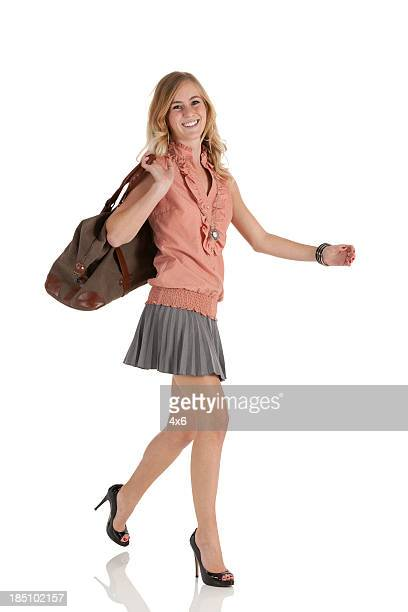 Happy woman carrying a hand bag