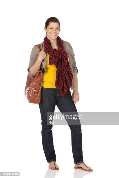 Happy woman carrying a leather bag