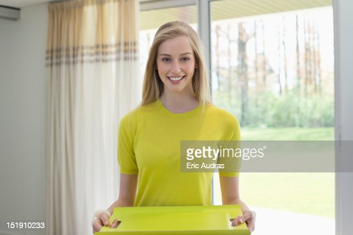 Happy woman carrying an empty tray