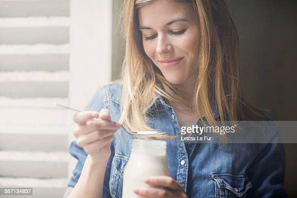 Happy woman drinking milk