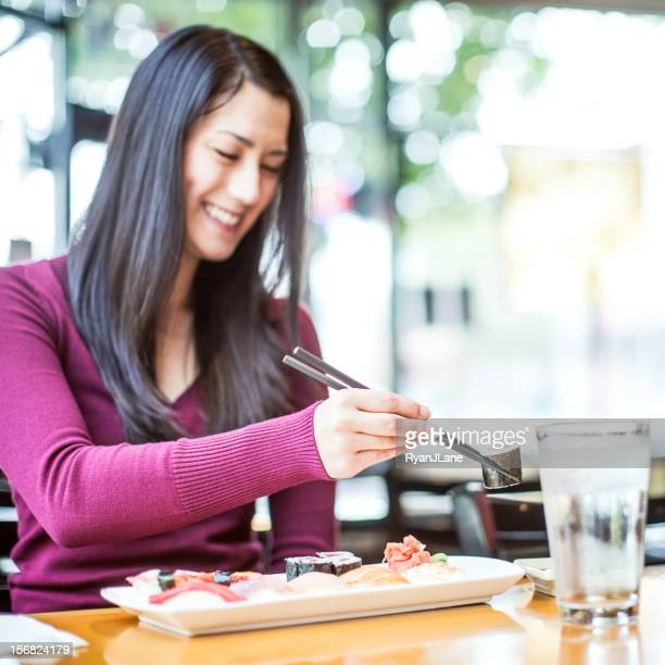 Happy Woman Eating Sushi