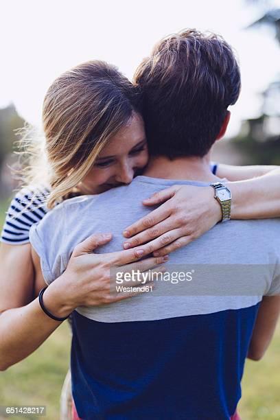 Happy woman embracing her boyfriend
