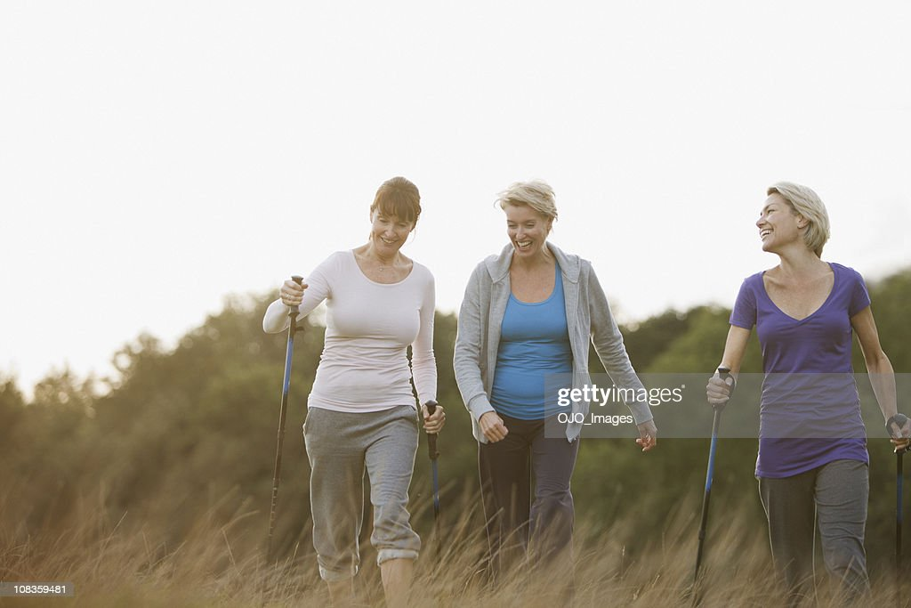 Happy woman hiking together outdoors