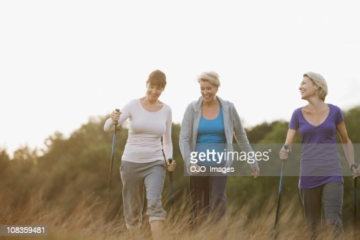 Happy woman hiking together outdoors : Stock Photo