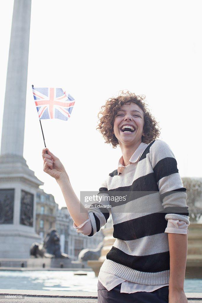 Happy woman holding British flag : Stock Photo