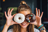 Happy woman holding donuts
