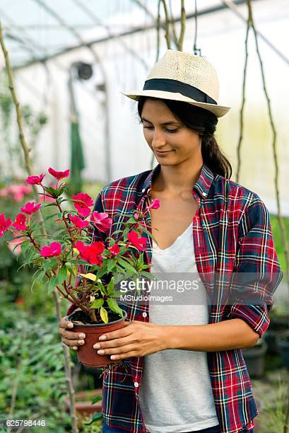 Happy woman holding flowers.