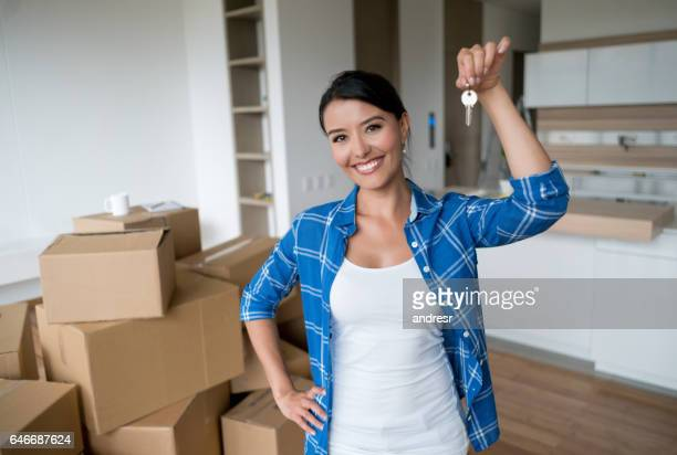 Happy woman holding keys to her new house