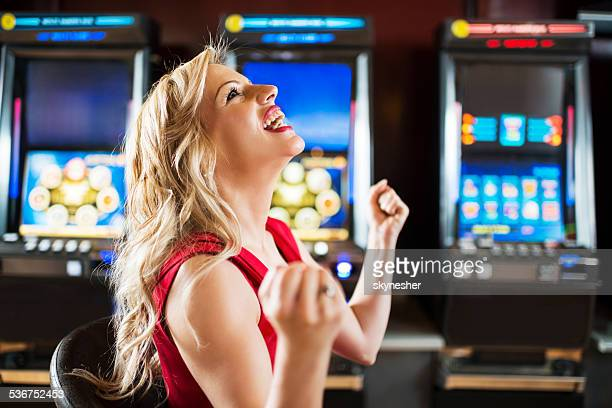 Happy woman in a casino.